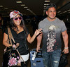 8 Feb 2010 - Snooki and new bf Emilio Antonio touches down at LGA Airport in NYC.  Photo Credit Jackson Lee