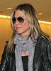 12 Mar 2010 - Jennifer Aniston arrived at JFK airport from London.  Photo Credit Jackson Lee