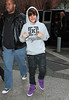 Justin Bieber is all smiles as he flashes peace signs for the paps in NYC