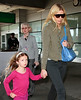 6 Apr 2010 - Gwyneth Paltrow, Apple Martin, Moses Martin arrive in NYC via JFK Airport.  Photo Credit Jackson Lee