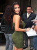 6 Apr 2010 - Kim Kardashian at the Regis and Kelly show in a dazzling green dress in NYC.  Photo Credit Jackson Lee