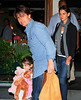 24 May 2010 - Tom Cruise, Katie Holmes, Suri Cruise are all smiles when they go for dinner at Il Cantinori in NYC.  Photo Credit Jackson Lee