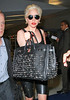 5 June 2010 - Lady Gaga arrives in NYC via JFK Airport.  Photo Credit GTS/Xposure