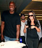 2010 July 2 - Khloe Kardashian and Lamar Odom arrive at JFK Airport in NYC.  Photo credit Jackson Lee