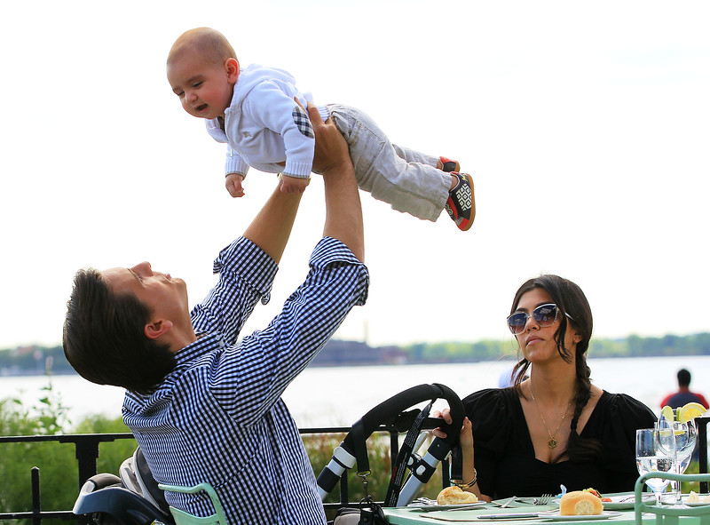 2010 July 02 - Scott Disick has his cute moments with his baby Mason and Kourtney Kardashian NYC. Photo credit Jackson Lee