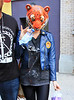2010 Aug 17 - Kesha out and about in NYC wearing a tiger mask.  Photo credit Jackson Lee