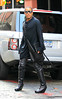 2010 Sep 23 - Lenny Kravitz wears leather pants and high heel boots in NYC. Photo credit Jackson Lee