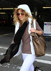 2010 Oct 18 - Annalynne McCord arrives to NYC via JFK Airport in NYC. Photo credit Jackson Lee