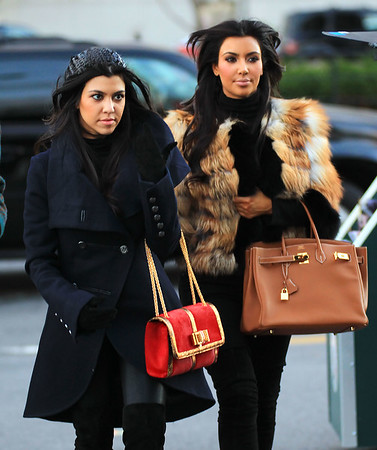 2010 Oct 29 - Kim Kardashian and Kourtney Kardashian board the circle line boat to go to Statue of Liberty, NYC.  Photo credit Jackson Lee