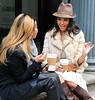2010 Nov 6 - Kourtney Kardashian and Adrienne Bailon talk on a stoop in NYC.  Photo Credit Jackson Lee