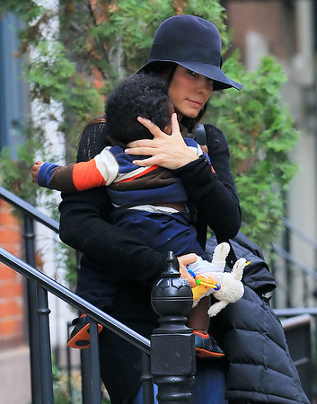 2010 Nov 6 - Sandra Bullock carries baby Lou while out and about in NYC.  Photo Credit Jackson Lee