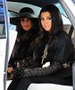 2010 Nov 14 - Kim Kardashian and Kourtney Kardashian films a scene getting out of a Bentley for their reality show in NYC.  Photo Credit Jackson Lee