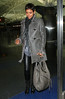 2010 Nov 15 - Halle Berry and Oliver Martinez walk hand-in-hand at JFK Airport in NYC.  Photo credit Jackson Lee