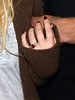 2010 Nov 21 - Jessica Simpson happily shows off her ruby engagement ring when arriving to JFK Airport with beau Eric Johnson.  Photo Credit Jackson Lee