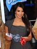 2010 Nov 23 - Kim Kardashian poses with two Charmin Bears in Times Square, NYC.  Photo Credit Jackson Lee