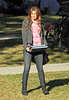 2011 Jan 15 - EXCLUSIVE: Miley Cyrus bears her midrif while carrying textbooks on the set of 'So Undercover' in New Orleans, La. Photo Credit Jackson Lee