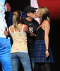 2011 Apr 8 - Charlie Sheen kisses 'goddesses' Natalie Kenly and Rachel Oberlin despite heckler's jeering on the first day of his New York City leg of his show 'My Violent Torpedo of Truth' at Radio City Music Hall. Photo Credit Jackson Lee