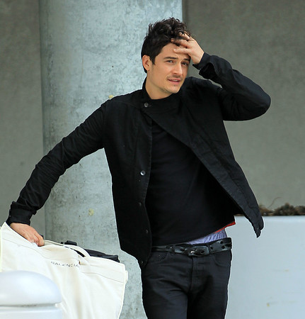 Non-Exclusive<br /> 2011 Apr 29 - Orlando Bloom checks out a classic MG Midget convertible car while waiting for his SUV at JFK Airport in NYC. Photo Credit Jackson Lee