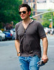 14 June 2008 - New York, NY - Matt Dillon crosses in front of a man sleeping on a chair while out and about in NYC.  Photo Credit Jackson Lee