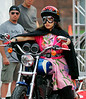 9 July 2008 - New York, NY - America Ferrera gets sprayed by silly string while on a Harley Davidson motorcycle in NYC with her co-stars Becki Newton and Michael Urie for 'Ugly Betty'.  Photo Credit Jackson Lee