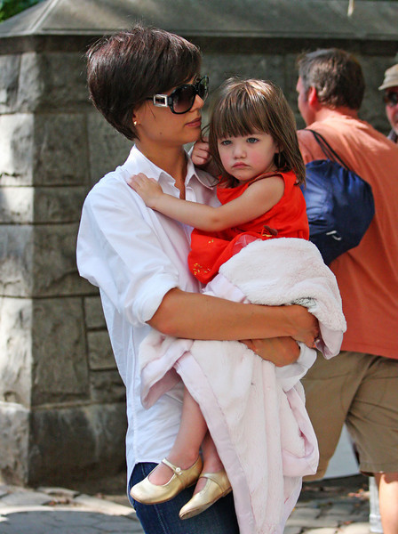 17 August 2008 - New York, NY - Katie Holmes carries Suri Cruise while out in Central Park together.   Photo Credit Jackson Lee