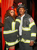 30 October 2008 - Mariah Carey and Nick Cannon celebrate the sixth mensiversary of their marriage by dressing as firefighters for Halloween and arriving on an NYFD fire truck.  Mariah is dressed in hot red mini skirt, bra, garters and stockings under a fire department coat. Photo Credit Jackson Lee