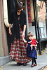 24 November 2008 - Suri Cruise walks clumsily as mom Katie Holmes takes her shopping in the West Village.   Photo Credit Jackson Lee
