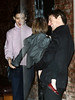 07 January 2009 - Katie Holmes smiles at Suri Cruise while Tom Cruise looks on in NYC. Photo Credit Jackson Lee