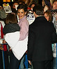 07 January 2009 - Tom Cruise keeps a watchful eye on Katie Holmes and Suri Cruise as he escorts them out of the Schoenfeld Theater after Katie's performance. Photo Credit Jackson Lee