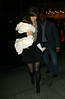 09 January 2009 - Katie Holmes fixes her skirt while arriving at the Schoenfeld Theater with Suri Cruise for one of her last evening performances. Photo Credit Jackson Lee
