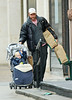 13 January 2009 - Liev Shreiber juggles three large bags of groceries and baby Alexander at the same time while Naomi Watts run errands separately. Photo Credit Jackson Lee