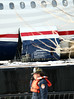18 January 2009 - US Airways flight 1549 Airbus A320 gets examined by investigators on a barge in lower Manhattan.  Note the damage to the engines and belly of the plane. Photo Credit Jackson Lee