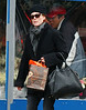 30 January 2009 - Julianne Moore shops at Yoyamart and then hails a cab in the Meatpackaging District. Photo Credit Jackson Lee