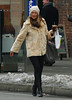 30 January 2009 - Molly Sims hails a cab with a bag and coffee in hand in the West Village, NYC. Photo Credit Jackson Lee