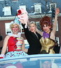 5 January 2009 - Renee Zellweger parades with Harvard men in drag in Cambridge, Mass. as Hasty Pudding honoree.  The itsy-bitsy Zellweger - dressed in a snappy black pantsuit, black overcoat and a pair of hot-red suede Christian Louboutin pumps - rode down Mass. Ave. on the back of a silver Bentley convertible waving to cheering fans, signing autographs and recording it all on her cell phone.. Photo Credit Jackson Lee
