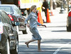 10 March 2009 - Angelina Jolie flags a cab barefoot and bloody on the set of 'Salt' in Washington, DC. Photo Credit Jackson Lee