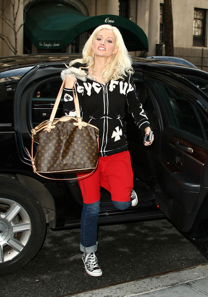 2 April 2009 - Holly Madison flashes a smile as she heads to an appearance on 'Live with Regis and Kelly' a day after she and Steve Wozniak get eliminated on 'Dancing with the Stars'. Photo Credit Jackson Lee