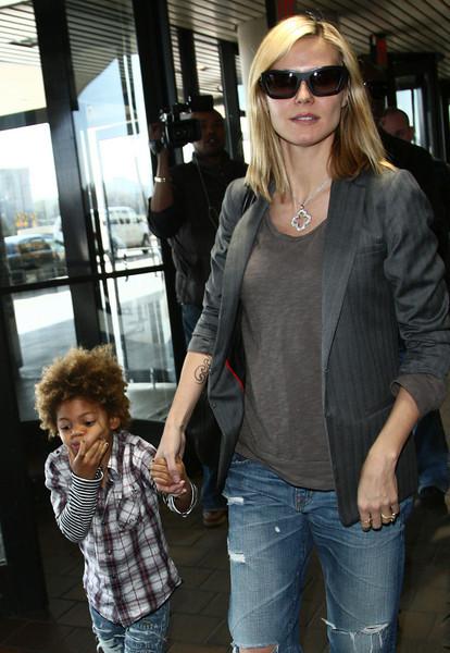 14 April 2009 - Heidi Klum and Seal take their kids to LaGuardia Airport in NYC.  Photo Credit Jackson Lee