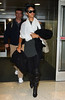23 May 2009 - Rihanna is all smiles as she makes her way through JFK airport. Photo Credit Jackson Lee
