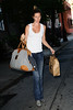 14 June 2009 - Gisele Bundchen heads out of her house with a bag inscribed 'One Lucky Duck.com' in NYC.  Photo Credit Jackson Lee