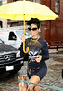 15 June 2009 - Rihanna carries a yellow umbrella while out and about in NYC.  Photo Credit Jackson Lee