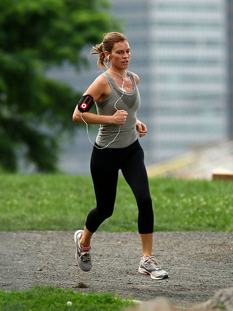 1 July 2009 - Hilary Swank takes a jog at a park with NYC and Brooklyn Bridge in the background on the set of 'The Resident' in DUMBO, Brooklyn, NY.  Photo Credit Jackson Lee