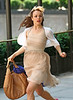 12 July 2009 - Rachel McAdams runs in a cream colored dress on the set of 'Morning Glory' just as the sun was setting in Midtown, NYC. Photo Credit Jackson Lee