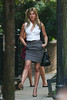 16 July 2009 - Jennifer Aniston kicks up her heels, then pick up dog poo at the set 'The Bounty' in the West Village, NYC.  Photo Credit Jackson Lee