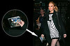 15 March 2006 - New York, NY - Lindsay Lohan holds a Fall Out Boy CD as she comes out to party for the fifth night in a row in NYC.  Photo Credit Jackson Lee