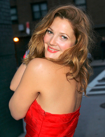 2 May 2007 - New York, NY - Drew Barrymore hams it up for the paparazzi in a dazzling red dress right before having dinner in downtown NYC.  Photo Credit Jackson Lee