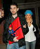 03 June 2007 - New York, NY - Christina Aguilera and Jordan Bratman carry a mysterious large red gift-wrapped package and a small gold gift-wrapped package.  Photo Credit Jackson Lee