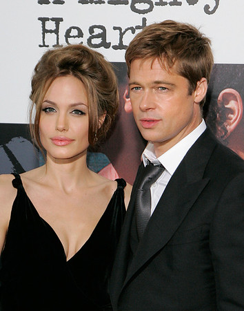 13 June 2007 - New York, NY - Angelina Jolie and Brad Pitt at the NY Premiere of 'A Mightly Heart' at Ziegfeld Theatre.  Photo Credit Jackson Lee