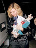 31 July 2007 - New York, NY - Madonna has decoration in mind as she comes back home carrying a variety of colorful drapes.  Photo Credit Jackson Lee