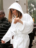 6 Aug 2007 - New York, NY - Beyonce wears a white robe to cope with the sweltering heat whilst filming a commercial for American Express.  Photo Credit Jackson Lee